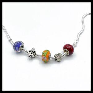 Großloch-Beads aus Metall und Glas